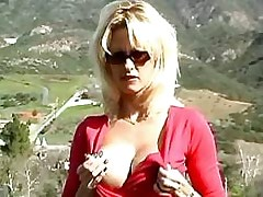 Sexy blond masturbates outdoors.Solo Gigrl.Slip nipple!