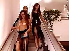 Two lesbian slaves lick madam in latex on stairs.Threesome lesbian porn.Fetish Lesbian Stories.Hot..
