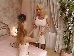 Mature and Girl Mature lesbian gives young a lesson.Busty Girls.Lesbian..