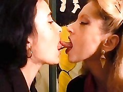 Mature lesbian seduces pretty chick.Girl kissing girl!