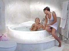 Beautiful lesbians relax in bath.Young sexy lesbian!