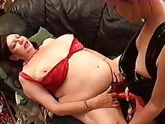 Fat Lisbian Slutty with strapon fucks lesbian fatty on sofa.BBW..