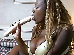 Lesbian Double Dildo Fat ebony chick enjoys huge dildo in hollow bed.Busty..