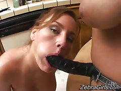 Blonde interracial lesbian licks out juicy pussy of redhead