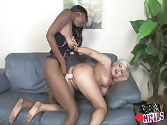 Horny interracial lesbian spoils innocent babe on leather sofa