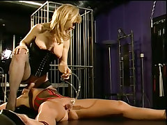 Melissa is tied down while nina hartley inserts dildos in..