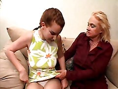 Granny lesbian spoils chick on sofa.Young sexy lesbian!