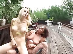 Mature lesbians share dildo outdoor!