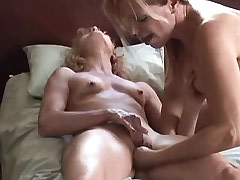Two lesbians caress and lick in bed.Sweet small titties.Lesbian mature sex!