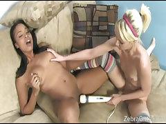Horny interracial lesbians share dildo on floor